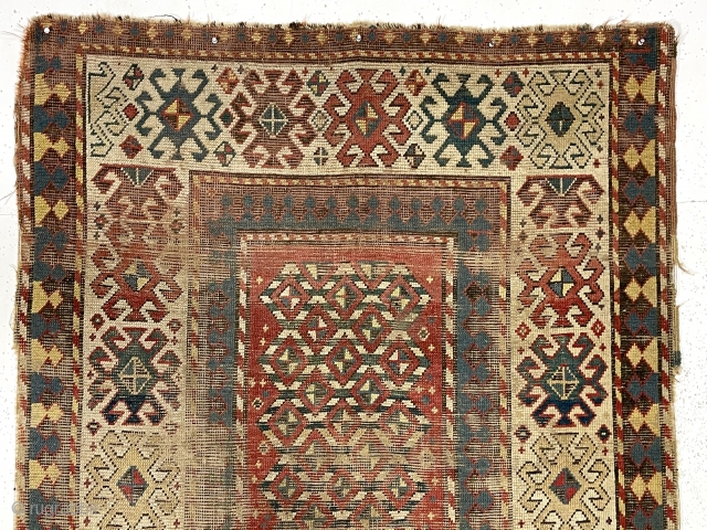 """Early Kazak rug with a very unusual field design. The weaver created a novel eye dazzling """"candy cane"""" lattice field and used traditional bold Kazak borders. All very good natural colors featuring  ..."""