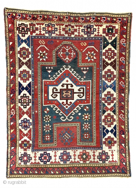 Antique Caucasian Kazak prayer rug with several very interesting features. Unusual eye catching ivory main border and an even more unusual minor border. All good natural  colors including a strong tomato  ...