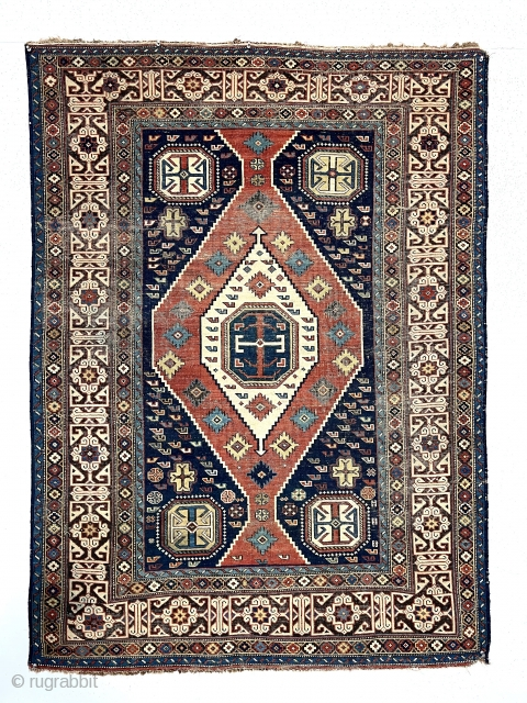 Antique Caucasian shirvan rug with a somewhat uncommon field paired with a nicely drawn Kufic border. Overall even very low pile with scattered wear and oxidation. All natural colors including nice yellow  ...
