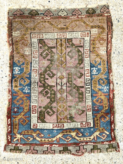 Antique Anatolian yastik. As found, very dirty and overall rough condition as shown. Interesting spacious field and border designs. Strange little weaving with strange colors ( I see no dye run ).  ...