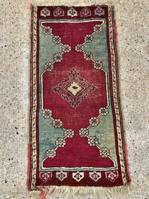 Antique Anatolian yastik in fair condition with very nice greens. Mostly decent pile with some light to moderate wear as shown. Original selvages. Natural colors including cochineal reds and real greens. As  ...