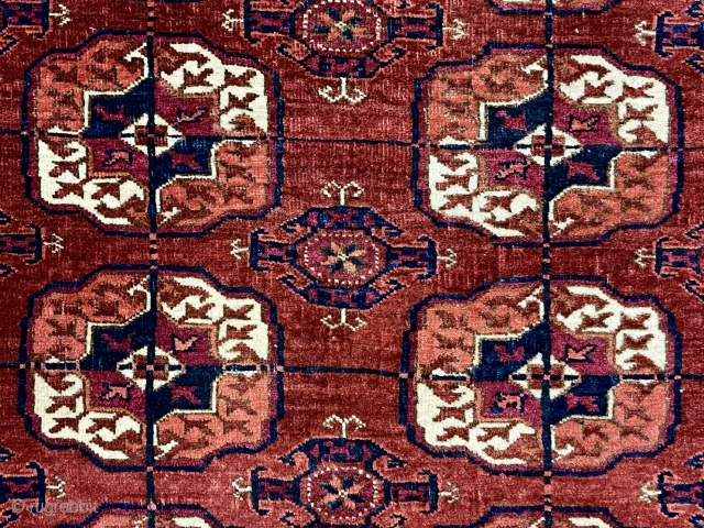 Older little tekke rug with good quality and soft lustrous wool. Nice rounded main guls and attractive minors. Overall mostly fair low pile with scattered wear as shown. A couple small spots  ...