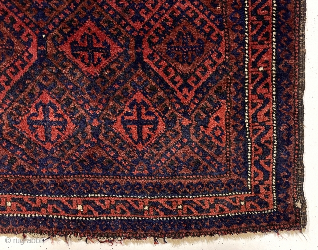 Early large Baluch bagface with rich color and beautiful soft lustrous wool. Complex diamond lattice field with a delicate meander border. Overall good pile. Original selvages. Wonderful cloth like handle. All natural  ...