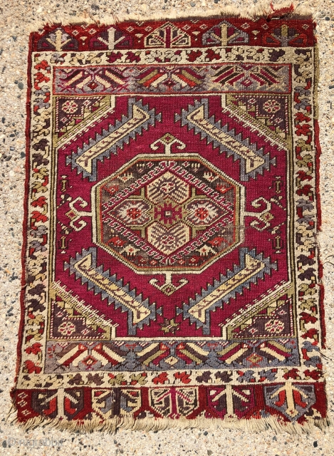 """Antique Anatolian yastik. Nicely drawn """"saz leaf"""" design with overall good even low pile. Likely Kersehir. Some heavy brown oxidation. Original selvages, a bit rough. Ends unraveling. Very colorful with no dye  ..."""