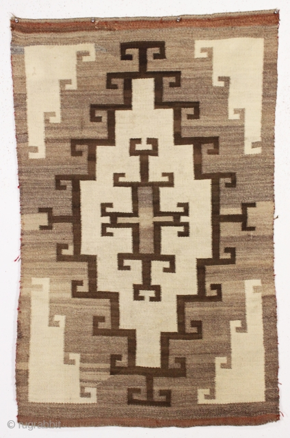 antique little navajo rug with an attractive design. Soft blanket like handle. Reasonably clean and in decent condition. I see one small sewn up repair visible in closeup back pic. late 19th  ...