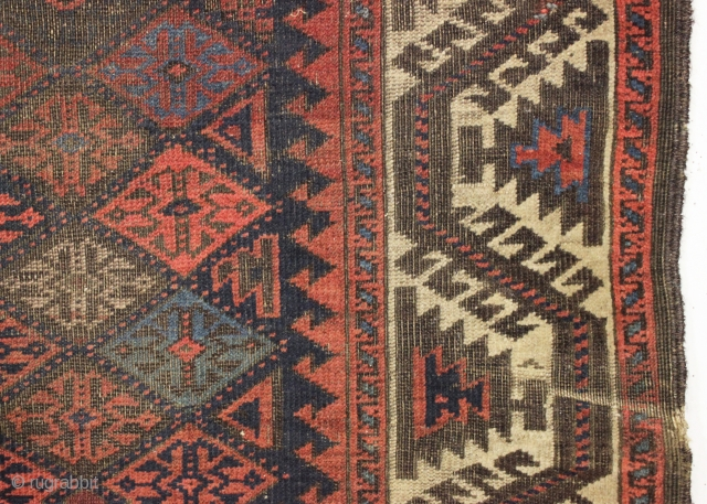 antique baluch rug displaying an early and interesting version of the turkman line, vine, or so called boat border. As found, very very dirty with wear as shown and priced accordingly. All  ...