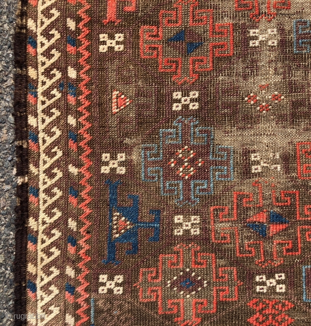 Antique small Baluch rug with an archaic spacious memling gul design and vivid old colors. Al natural colors including strong reds and eye catching light blues. Overall low pile with heavy oxidation  ...