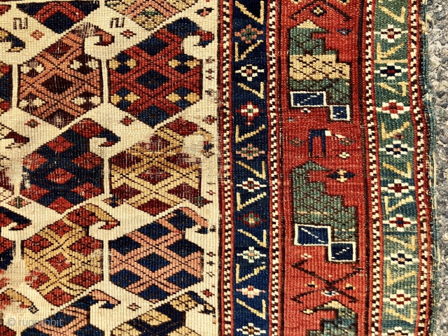 """Antique Caucasian ivory ground rug with an eye catch design of very colorful large boteh and a marasali type border with """"chessmen""""  or bird motifs. Mostly decent low pile but scattered  ..."""