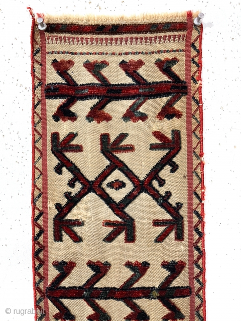 Antique Turkman tent band fragment. Attractive little example. All good natural colors featuring pretty medium blues. Mostly good condition other than the obvious crude repair in the lower medallion. Edges rewrapped. 19th  ...