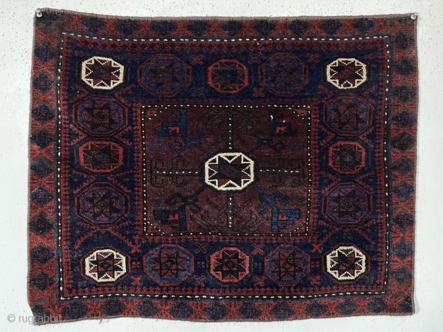 Antique Baluch bagface with classic octagon design and good thick lustrous pile. All natural colors featuring some pretty light blues. Edges not original and wrapped. Reasonably clean with nice floppy handle. Late  ...