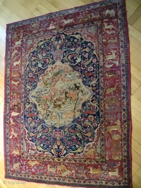 Persian Dragon rug, 187/145 cm.,19thC.Attributable either to Kirman(Kerman) because of the deep'Bordeaux'red, or to Isfahan because of the dragon and animal phantasies. This thin and exquisite rug has survived well due to  ...