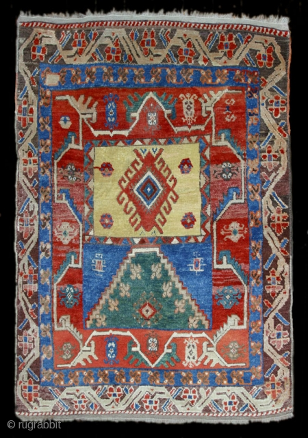 19th.c. Konya-Yürük,145X120cm with archaic design.Great condition,thick pile, and original selvages and kelim-bands.