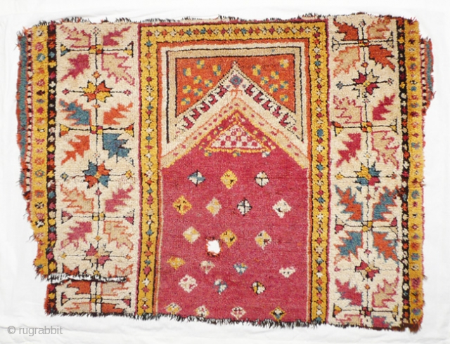 Fragment turkish prayer rug, 90x70 cm. Mid 19th.c. w/w. This Manastir-fragment has historical relevance,not because it still has a full pile,but because of it's colors,no longer from our world.Mounted on linen.