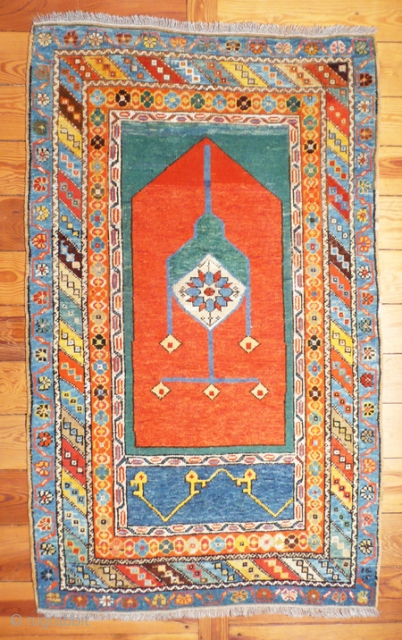 Anatolian prayer rug,150x90 cm w/w.No camera can catch the vibrant array of colors of this 19th.c.Konya piece.Apart from a few dime-sized professional repairs, hardly visible, it is in great shape and has  ...