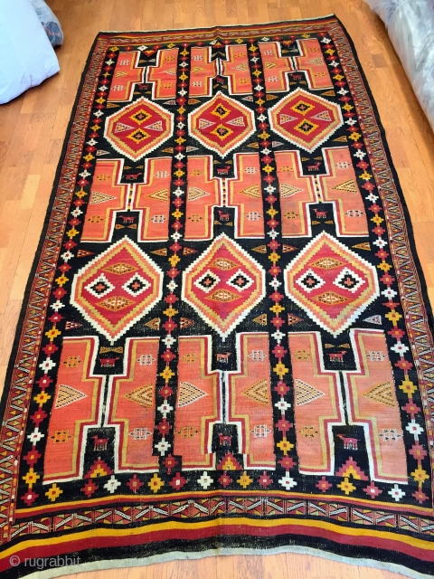 North African kilim Trabelsi recalling the origin of its weavers.Libyans from Tripolitania immmigrated to the mining towns around Redeyef, in south-west Tunisia shortly after the Italian occupation in 1912.   4''-11' x  ...