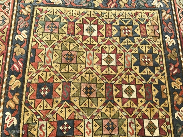 Antique Caucasian Gendge Rug - with rare barber pole lattice borders. Note the checkerboard inside the Stars ... Superbly detailed ..made with love. See more photos and details here: https://wovensouls.com/collections/use_throws?ls=en