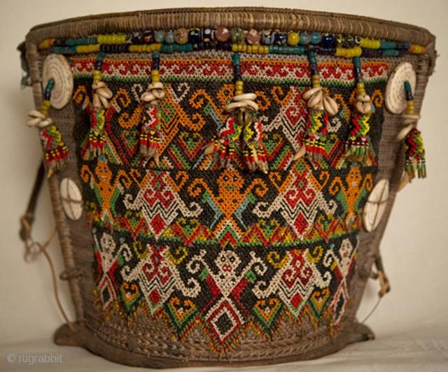 Auction Announcement: Rare Antique Tribal Textiles, Jewelry & Folk Art | June 30th, 2013 | Artfact.com | http://www.artfact.com/catalog/searchLots.cfm?scp=c&catalogRef=EP758QJN7M LOT 156 : Museum Quality Dayak Baby Carrier from Kalimantan, Borneo