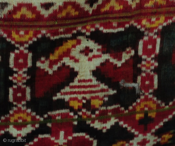 Antique Patan Patola Sari Fragment (quarter sari) pre 1900 Heirloom piece acquired from one of the two remaining weaving families of Patan, said to be with the family for over 200 years.  More  ...