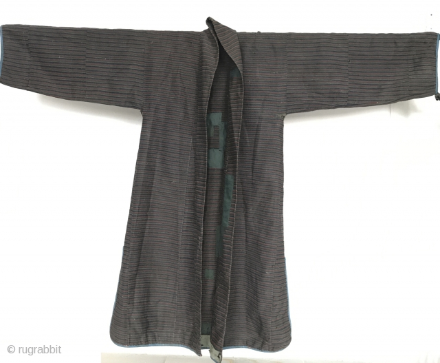 Superfine Pangden style weaving used in this rare man's overcoat from Tibet. 