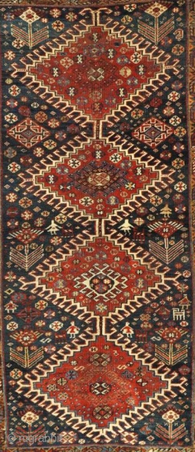 1325 Antique Qashqai Rug with 4 superbly executed medallions, 7 humans and 5 animals. See more photos and details here: https://wovensouls.com/collections/recent-additions-1