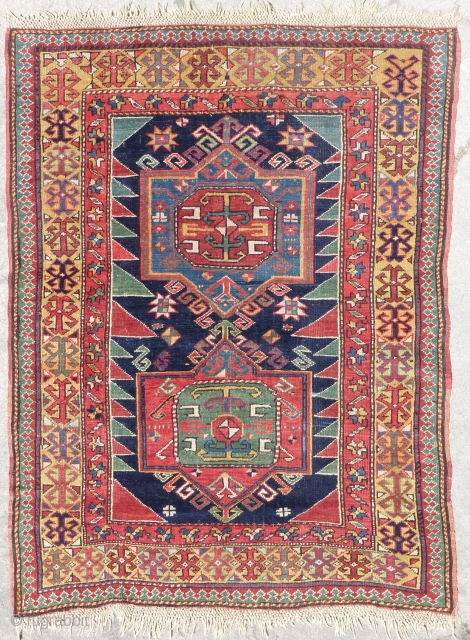 Shirvan rug (150cm. x 114cm./4'9'' x 3'7''), Very colorful piece with a nice golden border, good condition with original ends and selvages. Last picture is a picture of the back.