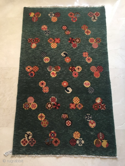 "#2050 Baotou rug, it was produced in Inner Mongolia, green background with nice colorful small group flowers. Good age and quality. Size 135*88cm(53*34"")"