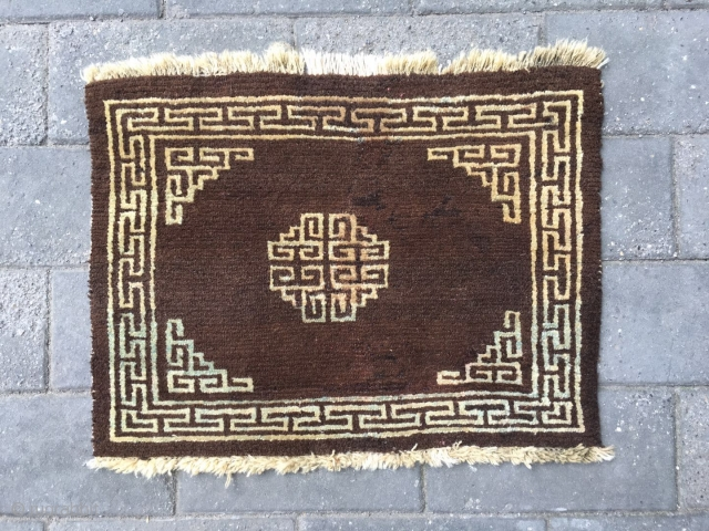 "#2065 Tibet rug, brown background with single group pattern, Hui veins selvage. Wool warp and weft. Good age and quality quality. Size 60*47cm (23*18"")"
