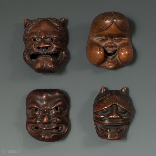 "Carved wood netsuke of Oni, Okame, Beshimi and Hannya, Japan. 1.75"" (4.5 cm) to 1"" (5 cm) high. Meiji Period 1868-1912"