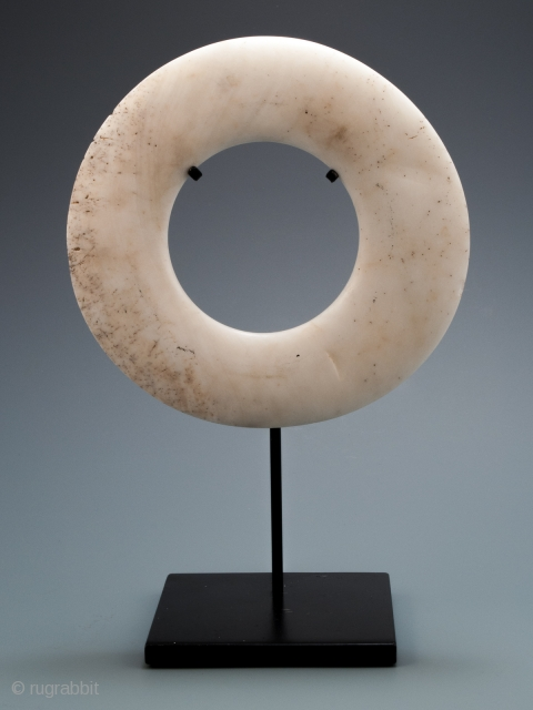 """Yua currency shell ring, Maprik area, East Sepik Province, Papua New Guinea. Tridacna shell. 6.5"""" (16.5 cm) diameter. Late 19th to early 20th century.  From the giant tridacna clam shell, currency rings were laboriously crafted with grit,  ..."""