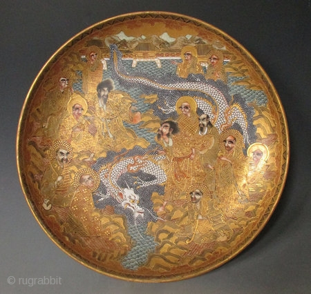 Japanese Antique Satsuma Bowl with Dragon   Beautiful Japanese Satsuma ware plate, decorated with a scene of a dragon surrounded on all sides by 14 Arhats standing on golden outcroppings of rock, the white  ...