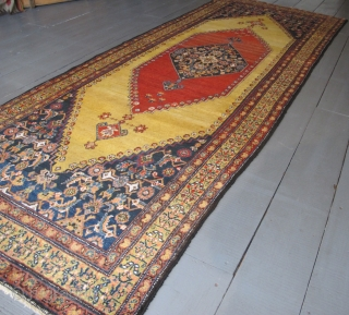 Kurdish Long Rug, 4.00m x 1.51m, dated circa 1910 (1230). Stunning saffron yellow field. Excellent condition.