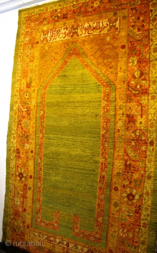 "19th century Ushak Prayer Rug 2.14m x 1.23m (7'1"" x 4'), wonderful fleecy Angora wool, silky texture. Great architectural drawing with inscription above the cartouche. Very good condition, with very minor restoration.  ..."