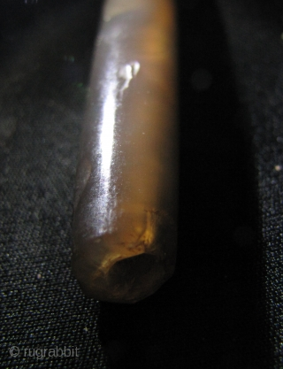 Long cylindrical tapered agate bead circa 6th to 9th CE, from Cambodia. It has a clean break and should be able to be repaired with a silver collar or a bit of  ...
