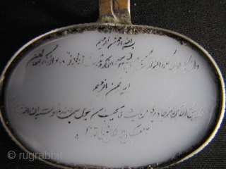 Islamic Glass Charm: Glass charm emulating white nephrite Jade inscribed with delicate Arabic writing on both sides, which I assume to be verses from the Koran. This set is in silver with  ...