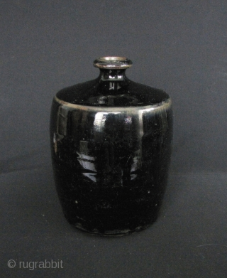 "Ming Dynasty Black Wine Jar: Lovely ""lacquer"" black glazed wine jar with russet highlights on the shoulder and mouthrim. Excellent condition, circa Ming Dynasty, could still be used. This basic shape has  ..."