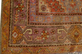 Xinjiang Carpet: Antique wool pile on cotton warp and weft antique rug from the Turkic speaking province of Xinjiang, China circa 19th or early 20th century. L: 2.75m/9ft and W: 1.6m/5ft2in. Just washed  ...