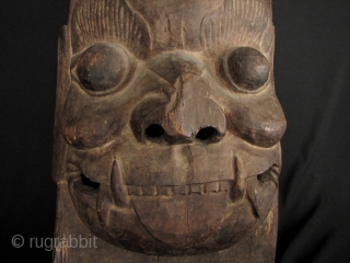 Chinese Door God Mask: Rare, circa early to mid 20th century carved wooden mask designed to be placed on or above a door to ward off evil spirits, in the animist Taoist  ...