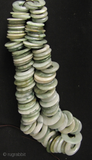 100 Jade Bi: One hundred antique perforated untreated Jadeite discs, circa 1880 to 1950. These were acquired from a Hong Kong jade dealer going out of business due to the ever increasing  ...