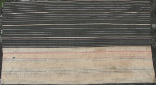 Semi antique woman's sarong from the Stieng/Xtiêng ethic group Vietnam. Over 60 years old, this is woven from all handspun cotton threads. There is one ink stain and a small hole (see  ...