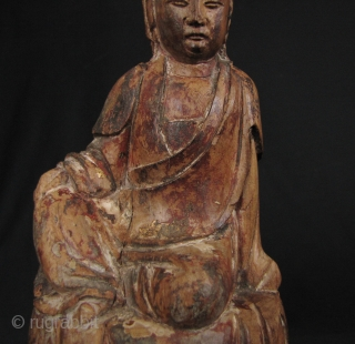 Qing Dynasty Guanyin: Lovely, circa 18th century wood statue of the Chinese Goddess of Mercy seated on a lotus leaf and buds.  There is one stem broken on the left bud  ...