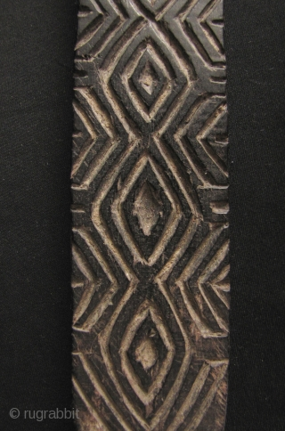 Iban Pottery Mold: Rare and unusual Iban pottery pattern paddle carved from durable Iron Wood, circa 19th century. The pattern on this would be pressed into unfired clay pots to give it  ...