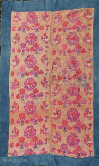 Chinese Wedding Blanket: Fine old silk brocade supplementary weft embroidered on cotton backing from the Mulao ethnic group, circa first half 20th CE. The foundation is woven with handspun blue cotton threads  ...