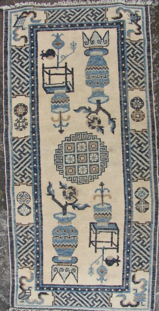 Baotou Rug: Good early 20th century rug, woven in Inner Mongolia with classic Bogu- precious objects pattern. Aside from about 1.5cm missing from the head ends this piece is in excellent condition-  ...