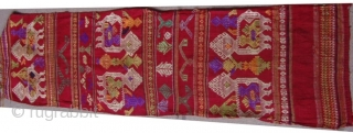 Tai Lue weaving, cotton supplementary weft with silk embroideries.   Tai Lue.   Minority group Laos and Thailand.   Seconed Quarter 20th Century.   0.87 X 0.24 CM
