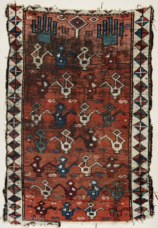 Worn and broken but very unusual and rare Eastern Anatolian (Karaman?) prayer rug, possibly Kurdish, with multiple ibriks. 19th c. 130x96 cm. Still to be mounted.
