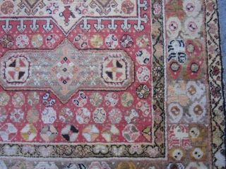 Antique Turkish Oushak circa 1900,measuring 6x4.This Oushak scatter rug has borrowed from many design sources.The border of triple flower modules is purely Turkish and it appears on Ghiordes Prayer rugs of the  ...