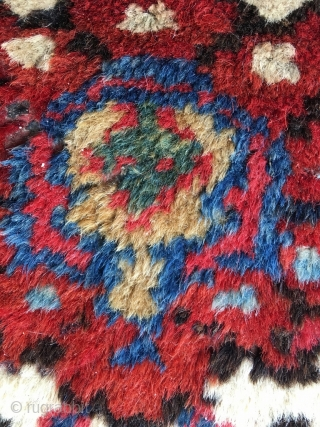 Heriz in very good condition with rare medallion and colors, such as duck-egg blue. High pile, glossy wool and vibrant colors. Minute area of wear, some mothing in the right hand top  ...