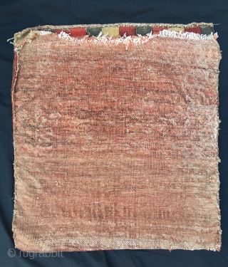 Sauj bulag bag with herati pattern, deeply saturated Geranium-red. Deeply patinated. Interestingly coarse back preserved. Soft dense pile, finely knotted. Wool on cotton. Nice triple border. Two moth bites obscured by the  ...