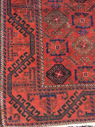 19th century Baluch, unusual Mina Khani design, wide ferocious border. Soft wool and good colors. Corrosion of black dye. Size 48.8 x 40.2 (124 x 102 cm).