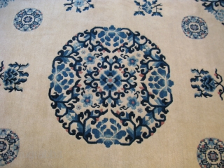 Semi-antique Chinese Peking rug, hand knotted wool pile on a cotton foundation, China, ca. 1940, several shades of blue on a beige field with a beige border, one large central medallion flanked  ...